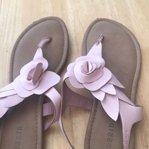 Sandals with a pink flower